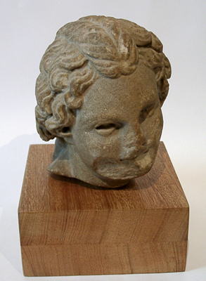 Unknown Roman Marble Carving of a Laughing Boy's Head with Wavy Hair