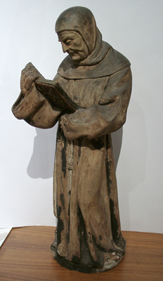 Unknown Terracotta Figure of a Monk Holding a Book
